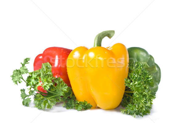 red, yellow and green pepper with parsley isolated on white Stock photo © artjazz