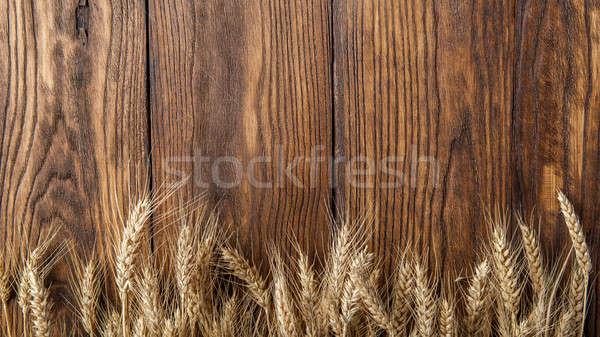 wheat on wood Stock photo © artjazz