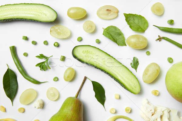 Friss zöld zöldségek gyümölcsök fehér egészséges étel Stock fotó © artjazz