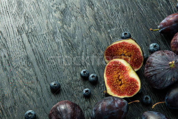 sliced figs and ripe berries Stock photo © artjazz