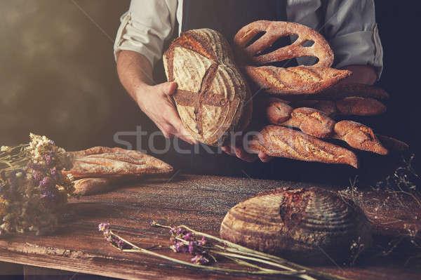 Variety of bread hold men's hands Stock photo © artjazz