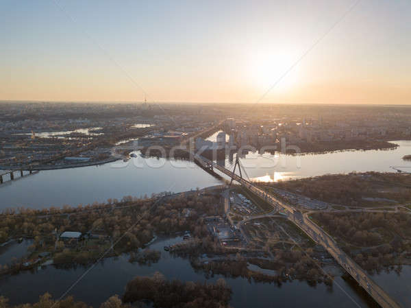 Aerial view on kiev city at sunset. The north bridge over the Dnieper River Stock photo © artjazz