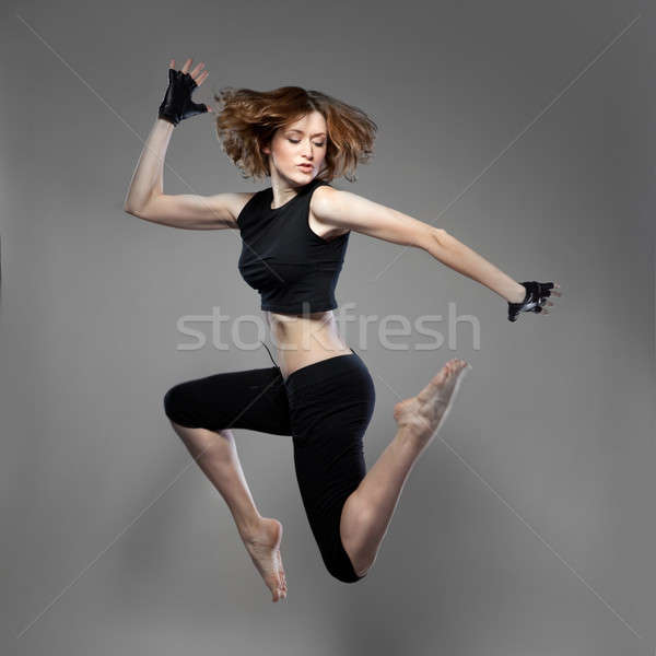 attractive jumping woman dancer Stock photo © artjazz