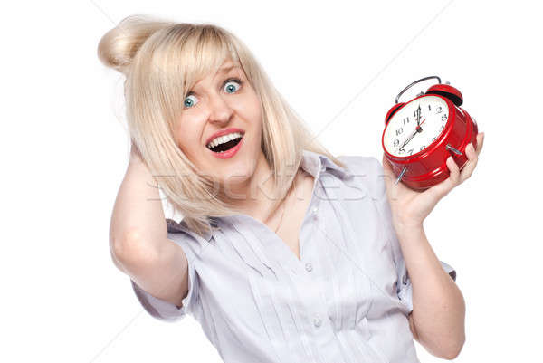 Shocked beautiful young woman with alarm clock isolated on white Stock photo © artjazz