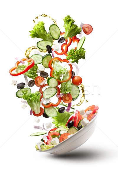 flying salad isloated on white Stock photo © artjazz