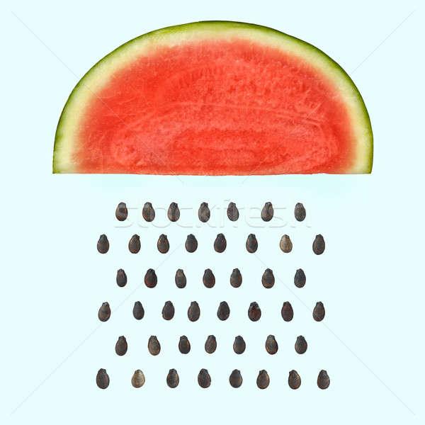 Görögdinnye szelet magok esik az eső világoskék terv Stock fotó © artjazz