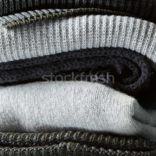 Pile of knitted winter clothes on background Stock photo © artjazz