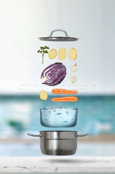 Friss zöldségek zuhan rozsdamentes acél edény repülés hozzávalók Stock fotó © artjazz