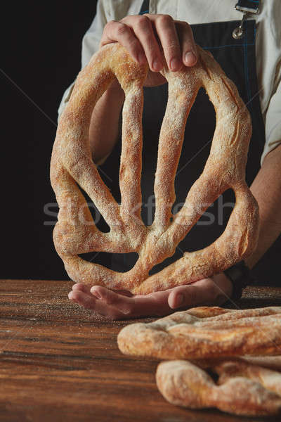 Hands men holding fougas bread Stock photo © artjazz