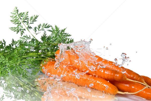 Eau douce Splash carotte isolé blanche eau Photo stock © artjazz