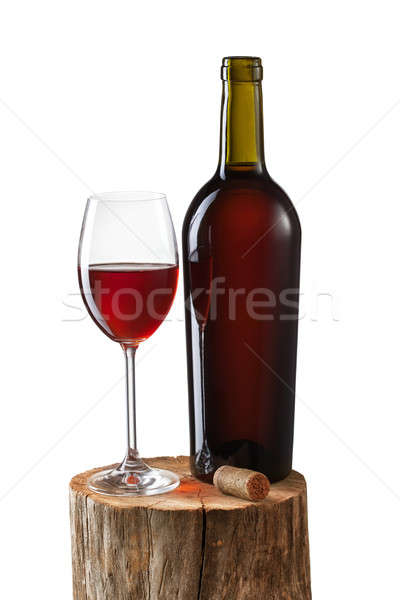 Glass of red wine and bottle on stump isolated on white Stock photo © artjazz