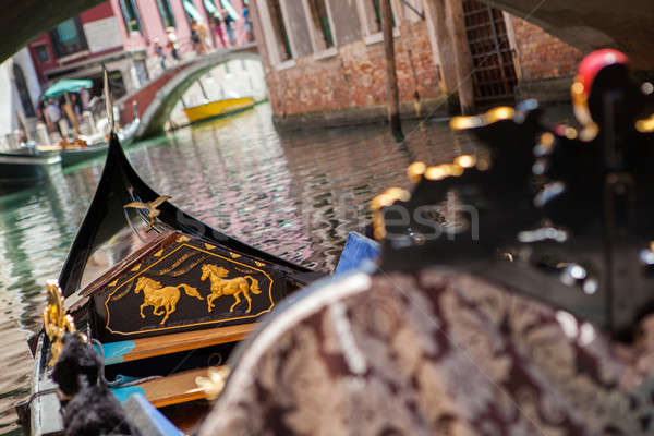 Gondola nose on water, Venice channel Stock photo © artjazz
