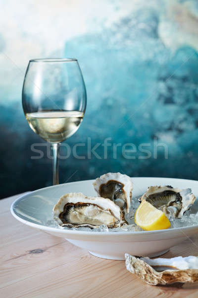 fresh oysters and a glass of wine Stock photo © artjazz