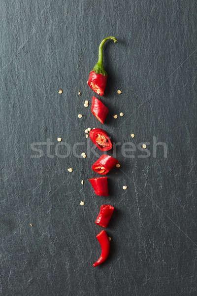 Rojo chile corte rebanadas aislado negro Foto stock © artjazz