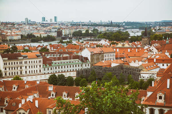 Houses with traditional red roofs in Prague Old Town Square Stock photo © artjazz
