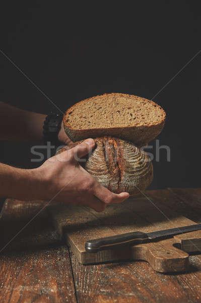 Men's hands hold bread Stock photo © artjazz
