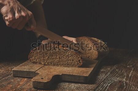 Kezek vág rozs kenyér pék vág Stock fotó © artjazz
