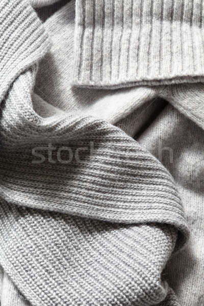 large folds on the warm knit grey scarf Stock photo © artjazz