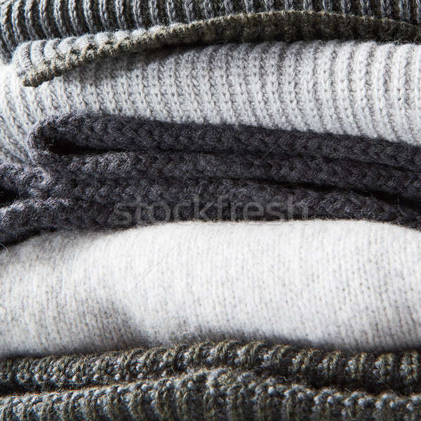 stack of warm winter knitted sweaters Stock photo © artjazz