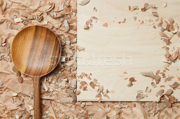 Wooden spoon on parchment Stock photo © artjazz