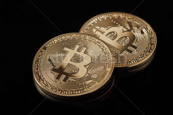 Digital currency physical golden bitcoin coins on black background Stock photo © artjazz