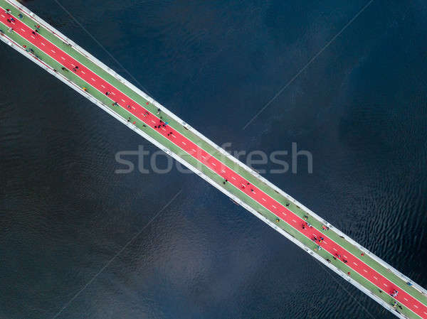 Aerial top view of pedestrian and cycling path lane on Park bridge and Dnieper river from above in c Stock photo © artjazz