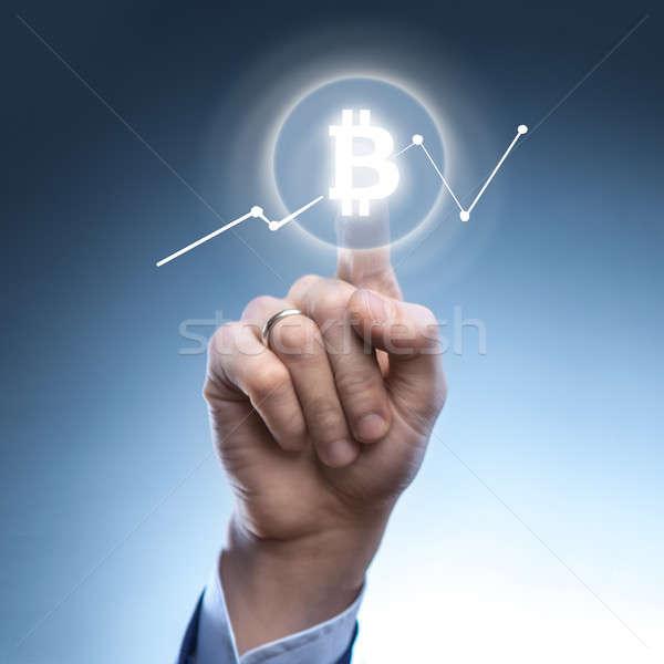 Homem ícone bitcoin virtual tela mão Foto stock © artjazz