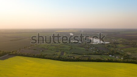 Panoramic view of the field and a small village in the distance against the blue sky, Ukraine Stock photo © artjazz