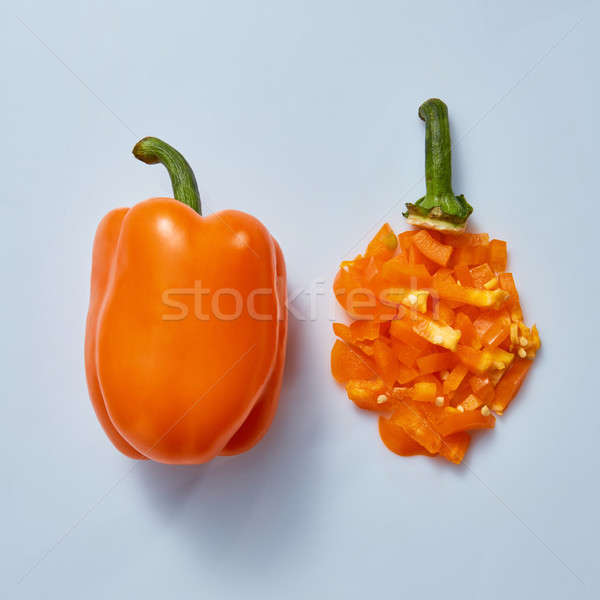 whole and sliced yellow sweet peppers on a gray background Stock photo © artjazz