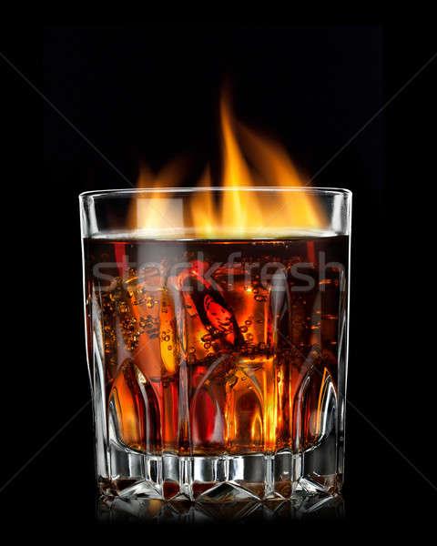 Kóla konyak tűz üveg fekete absztrakt Stock fotó © artjazz