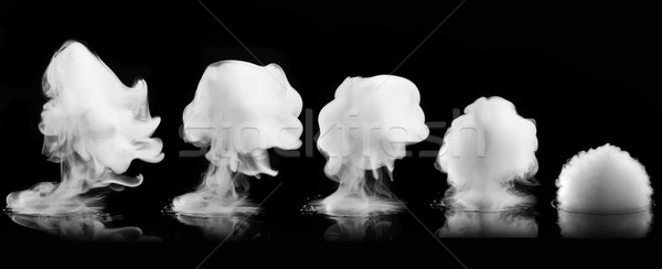 White smoke explosion isolated on black Stock photo © artjazz