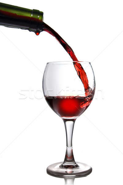 Stock photo:  Pouring red wine in goblet