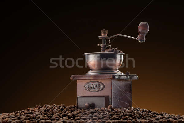 Stock photo: Retro manual coffee mill on roasted coffee beans