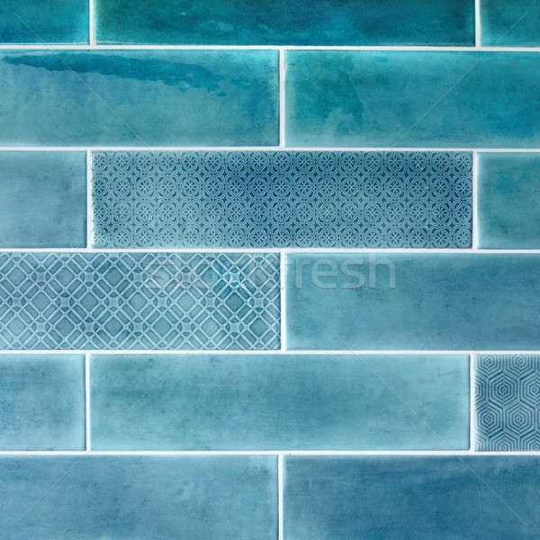 Ceramic tiles on the wall in blue. Stock photo © artjazz