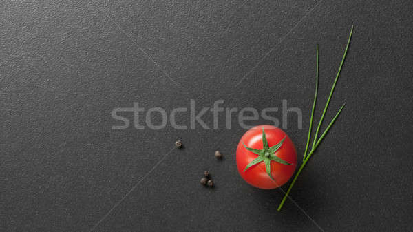 red tomato with green onion on black Stock photo © artjazz