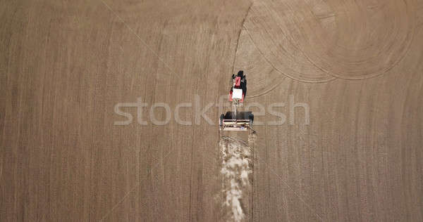 Aerial view tractor in the field, spring works Stock photo © artjazz
