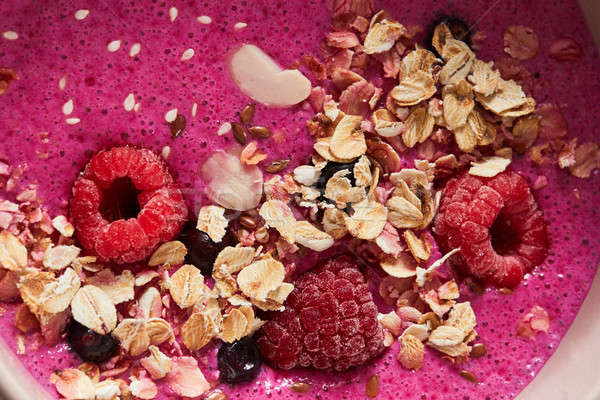 Close-up of smoothies with berries, oatmeal and flax seeds. Healthy breakfast Stock photo © artjazz
