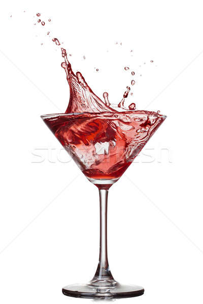 Red cocktail with splash isolated on white Stock photo © artjazz