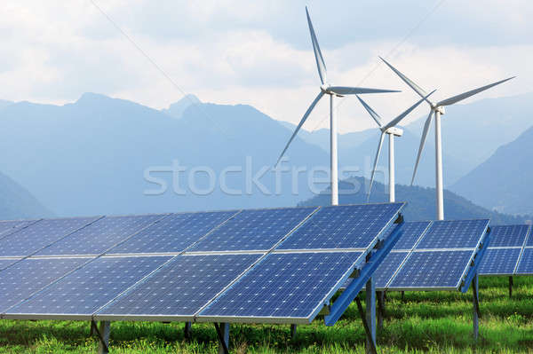 solar panels and wind turbines against mountains Stock photo © artjazz