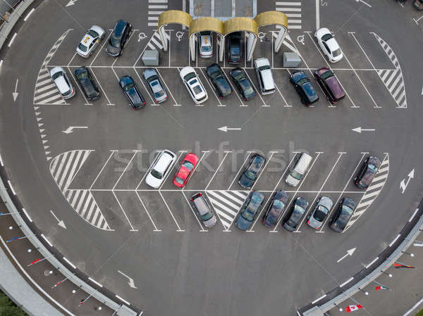 Birds eye view from the drone is strictly above the parking with cars. Stock photo © artjazz