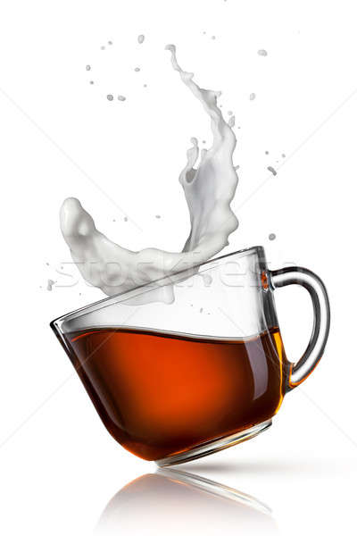 cup of black tea with milk splash isolated on white Stock photo © artjazz