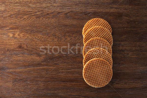Waffles with caramel on wood Stock photo © artjazz