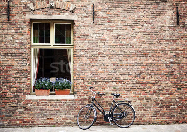 Stock photo: Bicycle parked outside shuttered windows