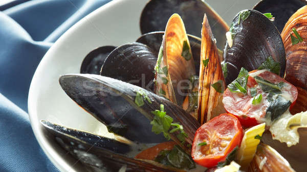 Close-up of boiled mussels with lemon Stock photo © artjazz