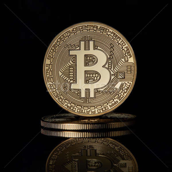 Stacked golden bitcoins coins for BTC cryptocurrency on a black reflective surface background Stock photo © artjazz