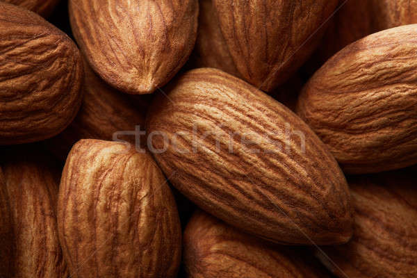 Organic texture of almonds. View from above Stock photo © artjazz