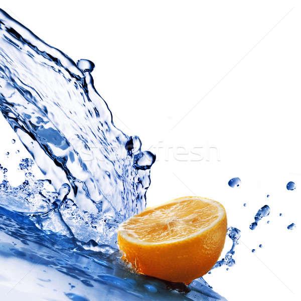 Zoetwater druppels oranje geïsoleerd witte voedsel Stockfoto © artjazz