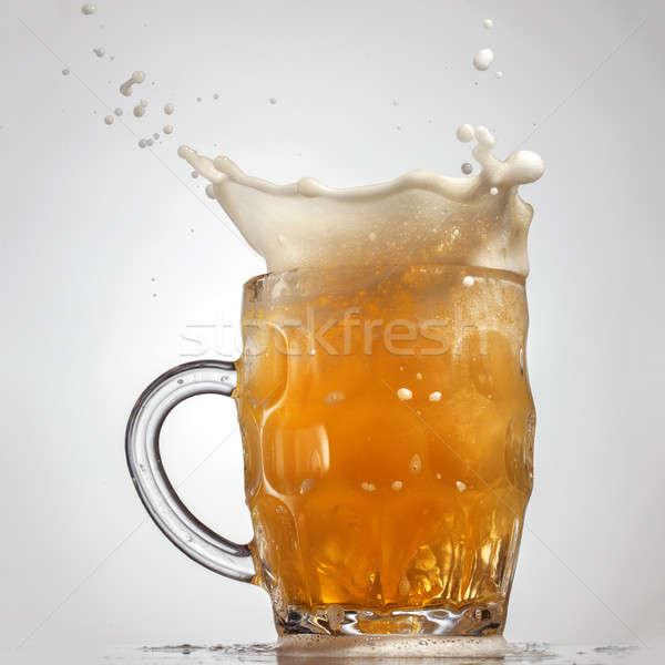 Beer splash in glass isolated on white Stock photo © artjazz