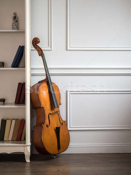 Cello in classical interior with bookshelf Stock photo © artjazz