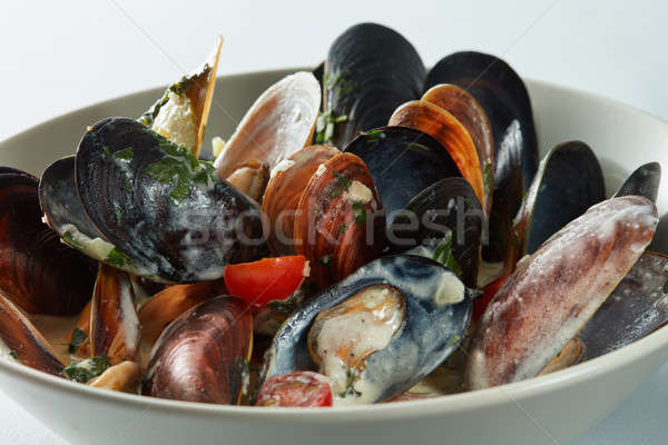 Mussels in the bowl in a white wine sauce Stock photo © artjazz